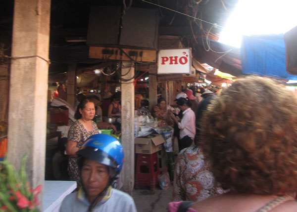 you can't see her, but the back of that head is my mom as we weave through the crowds in the market.